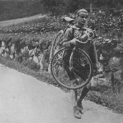 Person Carrying a Bike